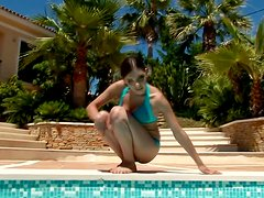 Some Sexy And Sensual Poolside Antics With A Brunette