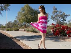 Casey undresses in the street and shows her goods!