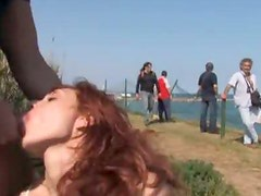 Hot Redhead Gives a Blowjob In Public After Getting Her Pussy Toyed