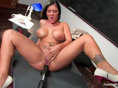 Machine Fucking With A Busty Brunette In A Classroom