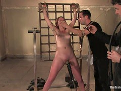 Helplessly Tied Up Redhead Has Fun In A Bondage Scene