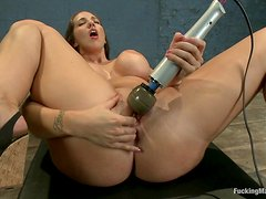 Busty brunette gets her pussy stuffed by machine cock