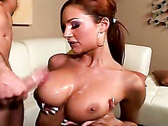 Amy Reid gets sprayed with a fresh load of cum on her juicy juggs