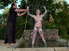 Big tits girl put in bondage by master outdoors