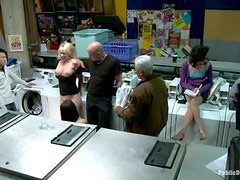 Horny Missy Woods gives a blowjob in a laundry in public
