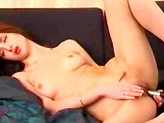 Cute redhead babe is playing with a trimmed puss