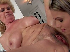 Effie is a big titted granny with wet hairy pussy.