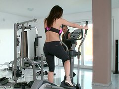 A big boobed brunette doll finishes her workout and fucks