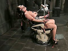 Model with massive tits is machine-fucked and hosed down
