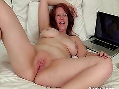 Ginny plays with her wet pussy