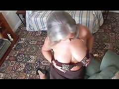 MILF Attractive busty granny in stockings