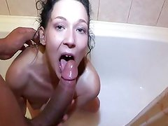 Surprised brunette fucked in the shower