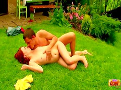 Redhead laid in the grass