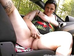 Milla gets wet washing her car