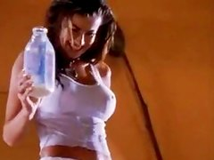 Carmen Electra pours milk on her hot tits