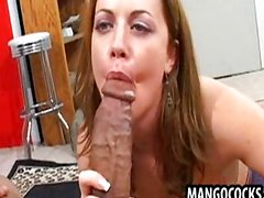 Chick sucking on two huge cocks