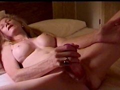 This MILF is satisfying herself with the vibrator