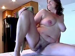 Сhubby mature shows her body in kitchen
