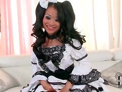 Asian girl in intricate white dress is tasty