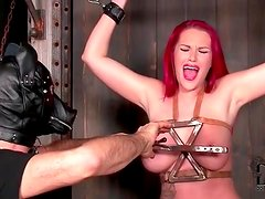 Busty redhead enjoys the tit torture and flogging