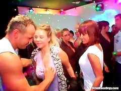 Male dancers blown by beautiful women at party