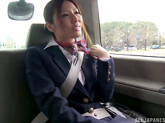 Yuna Shiina lets some guy rub her tits with a toy in a car