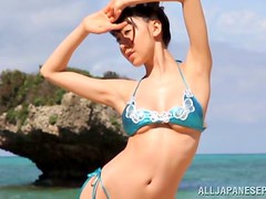 Meisa Chibana gives a blowjob and gets fucked at a beach