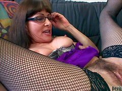Alexandra Silk is a four-eyed mature brunette in mesh stockings.