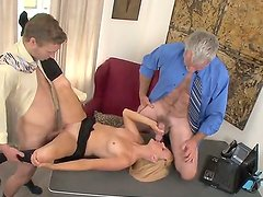 Mature boss invited his young son to visit his office and taste something delicious. He