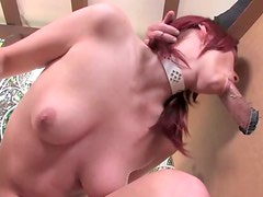 Naughty red haired bitch Marsha Lord is serving delivery guy