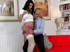 Zealous wanker Lou Charmelle moans while tickling her wet pussy on couch