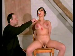 Shaved Asian with fake tits likes hot wax pain