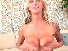 Tattooed bitch  Brooke Banner receives a portion of cum on her gorgeous tits