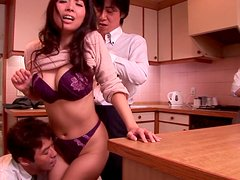 Kinky jade Chihiro Kitagawa is sucking two sausages in the kitchen