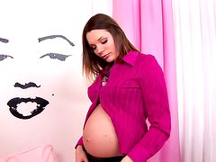 Pregnant babe is lying and masturbating