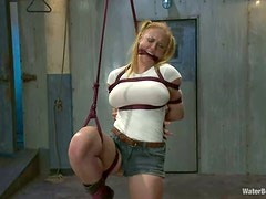 Sexy blondie gets her tits bondaged and twitched