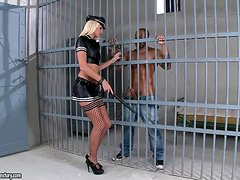 Sexy prison guard is punishing two detainees