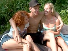 Curly redhead and sweet blondie turn a picnic into a super hot threesome