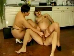 Very pregnant brunette gets fucked in a FFM threesome in the kitchen
