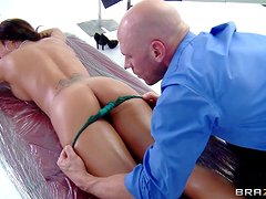 Topless brunette Capri Cavanni gets her back and sexy perky