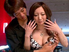 Alluring Japanese milf Ayami gets her shaved cunt finger fucked