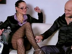 Bald headed dude in collar licks the feet of rapacious brunette in stockings