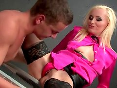 Sexy blonde in pink blouse sucks a dick