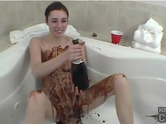 Solo teen covered in slippery chocolate sauce