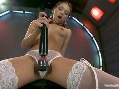 Cute babe in stockings gets pleased by a machine