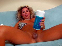Ariel Everittsis a curly haired sexy tranny with long legs.