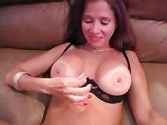 Sexy mom licks the cum from her tits