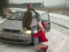 Playful blond Snow Maiden Jane Darling gives blowjob to horny dude in snowy street