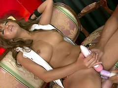 Dildo addicted busty and tanned Asian clown face gets pleased with a dildo