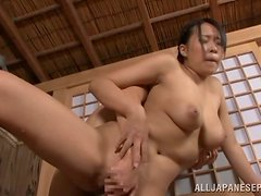 Bosomy Japanese milf gets fucked from behind in a sauna